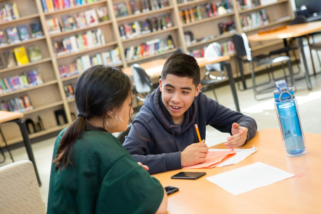 Students at Skyline High School work together during an after-school tutoring club.